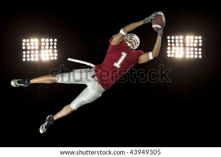 American football player in action with ball