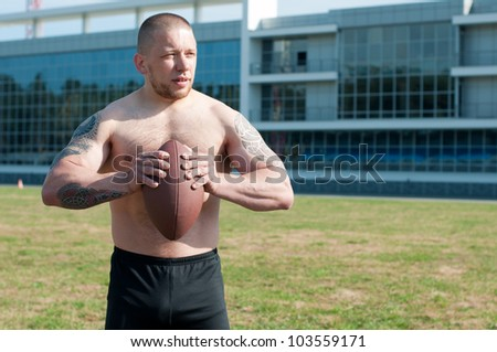 American football player just about to pass the ball - stock photo