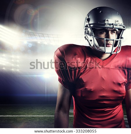 American football player looking away against american football arena