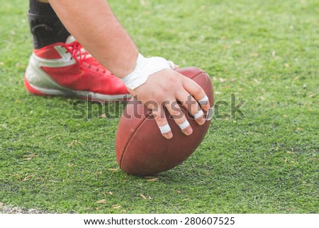 American football player passing the ball.