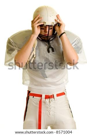 American football player. Putting on helmet. - stock photo