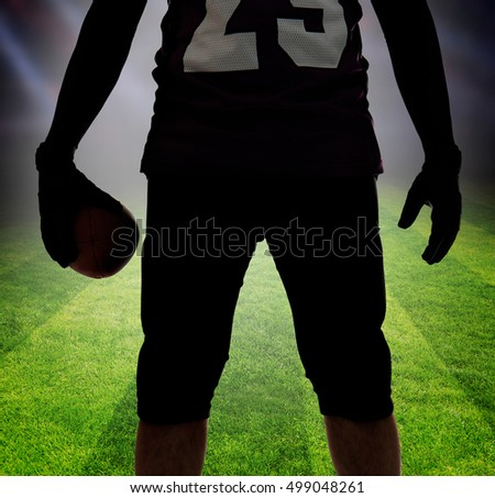 American football player silhouette on football field background