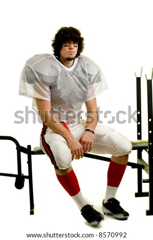 American football player. Sitting on weight bench.