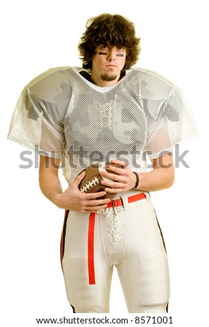 American football player. Standing with ball.