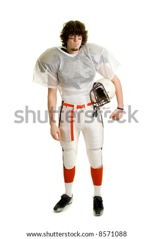 American football player. Standing with helmet.