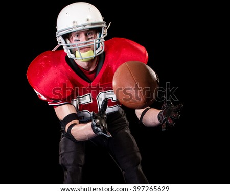 American football player. Studio shot over black.