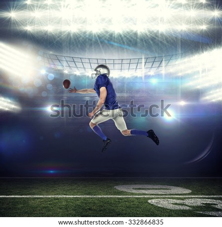 American football player trying to catch the ball against american football arena - stock photo
