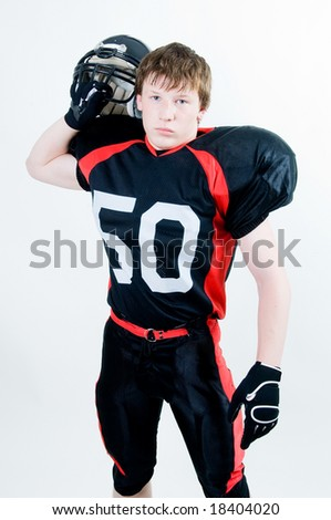 American football player with helmet, studio isolated - stock photo