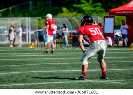 american football player with out of focus players in the background  - stock photo