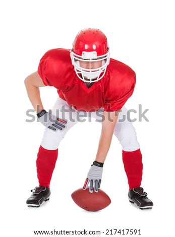 American Football Player With Rugby In Pose Over White Background - stock photo