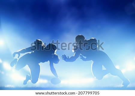 American football players in game, touchdown. Night stadium lights - stock photo