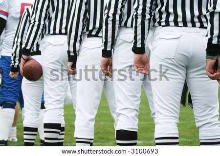 American football referee holding ball. American football concept - stock photo
