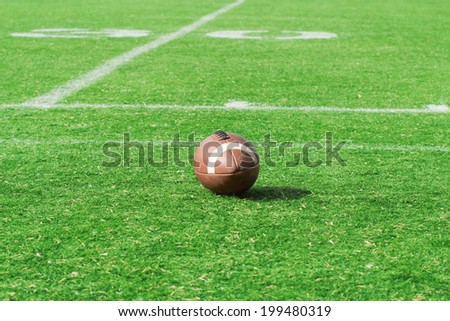 American football/rugby ball on the court.