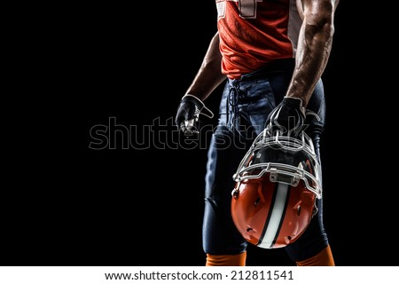 american football sportsman player in black isolated - stock photo