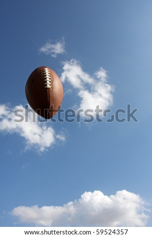 American Football traveling thru the sky