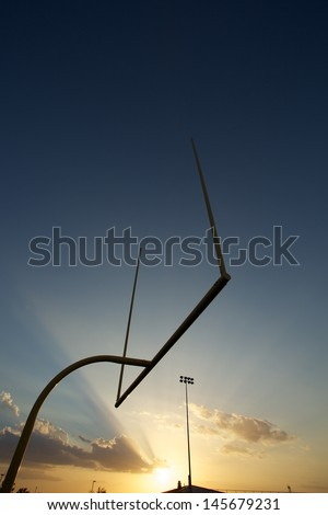 American Football Uprights or Goal Posts at Sunset - stock photo