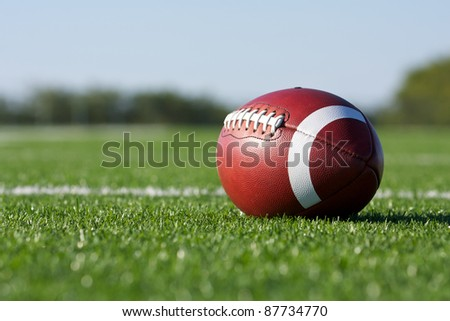 American Football with the Field Beyond - stock photo