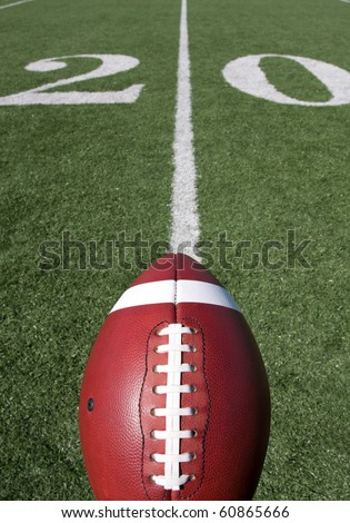 American Football with the Twenty Yard Line Beyond - stock photo