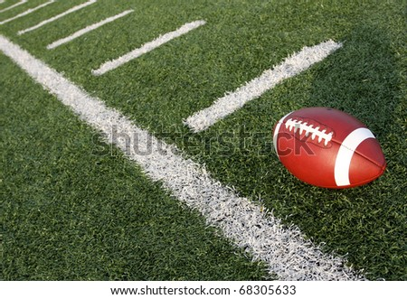 American Football with the yard lines carrying off - stock photo