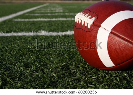 American Football with the yard lines or hashmarks beyond - stock photo