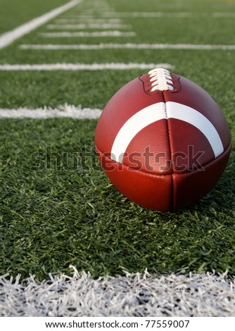 American Football with yard lines or hashmarks Beyond - stock photo