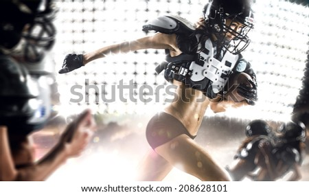 American football woman player in action - stock photo