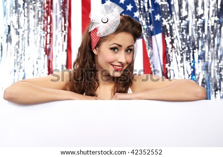 American girl holding blank board. Flag background - stock photo