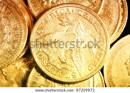 American gold coins on dark background - stock photo