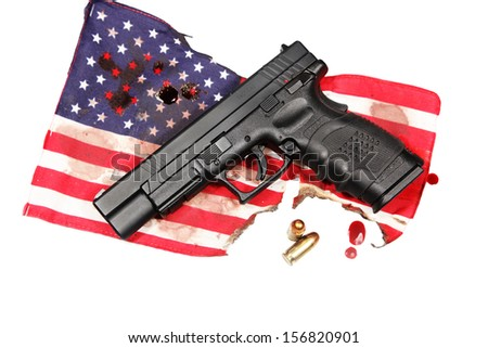American Gothic Series/black automatic pistol laying upon burnt, blood-stained US flag with blood drops isolated alongside & two cartridges - stock photo