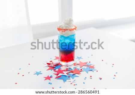 american independence day, celebration, patriotism and holidays concept - glass of cocklatil drink with whipped cream and stars confetti decoration on american independence day party - stock photo