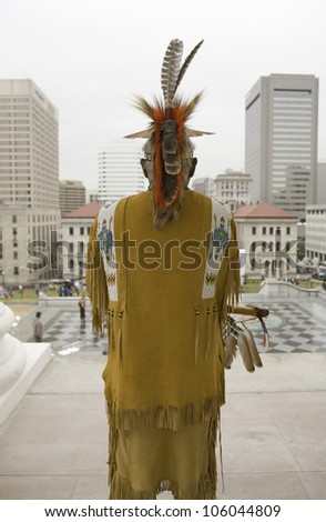American Indian and Powhatan Tribal member, looking over Richmond Virginia from State Capitol during ceremonies for the 400th Anniversary of the Jamestown Settlement on May 3, 2007 - stock photo