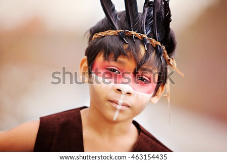 American Indian.  Close up of a young, mixed race boy, dressed as a Native American Indian.