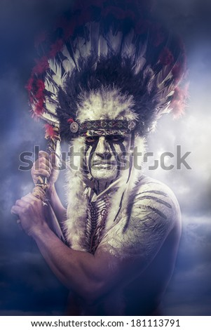 American Indian warrior, chief of the tribe. man with feather headdress and tomahawk, clouds - stock photo