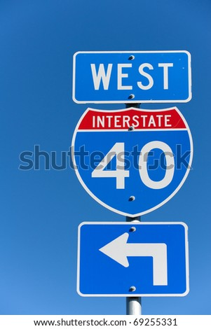 American Interstate I-40 West sign on blue background - stock photo