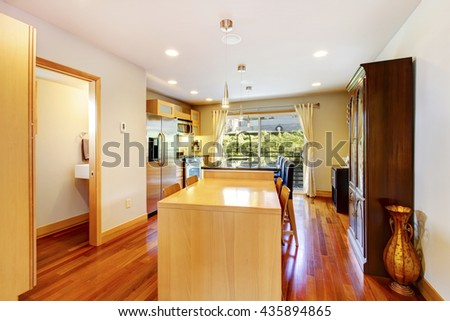 American kitchen room interior with wood cabinet, stainless steel fridge and glass door leading to balcony - stock photo