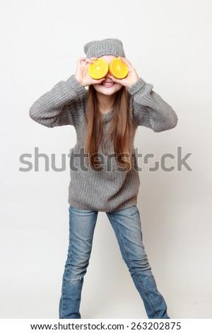 American little girl holding citrus  - stock photo