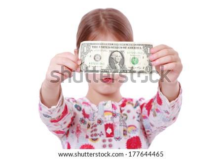 american little girl holding one dollar - stock photo