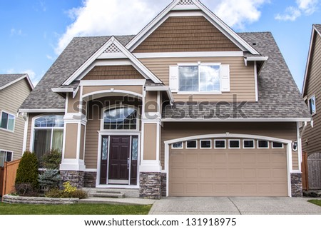 American luxury suburbs home with blue sky - stock photo