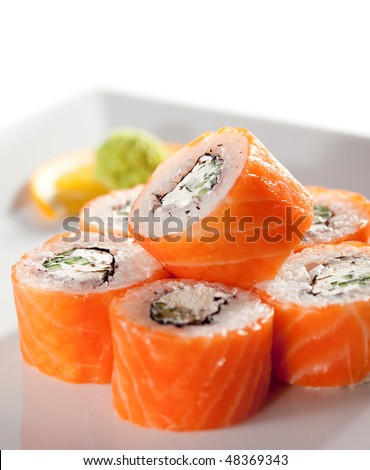 American Maki Sushi - Philadelphia Roll made of Fresh Raw Salmon, Cream Cheese and Cucumber - stock photo