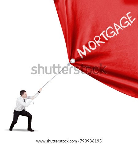 American male entrepreneur pulling a fabric with mortgage word, isolated on white background