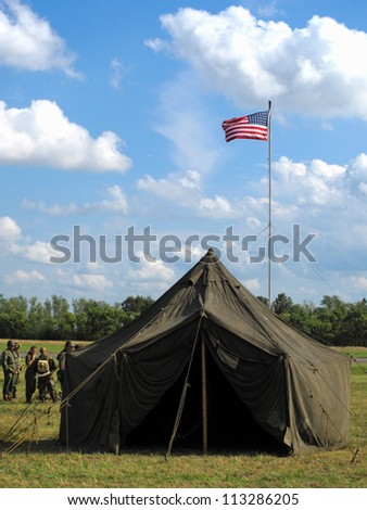 American military camp with flag from second world war era. - stock photo