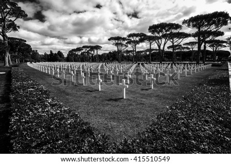 American military cemetery with white crosses in a meadow of green grass in Nettuno in Italy in black and white - stock photo