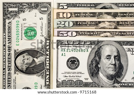 American money fanned out. 100, 50, 20, 10, and 5 dollar notes.  A one dollar bill is on the left. Isolated on white. - stock photo