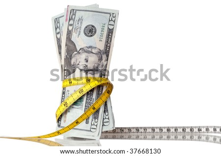 "American money with a tape measure around the ""waist"" - stock photo"