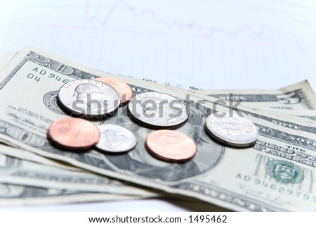 American money with focus on silver coins with the financial graph in the background. - stock photo