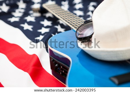American musicians. Six-string guitar on the background of the flag State. Hat and glasses