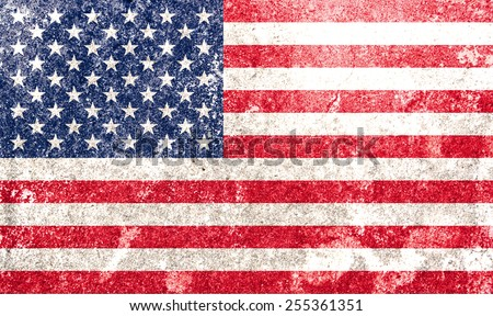 American national flag on grunge stone wall background