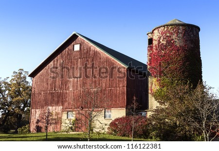 American old country farm with barn and silo - stock photo