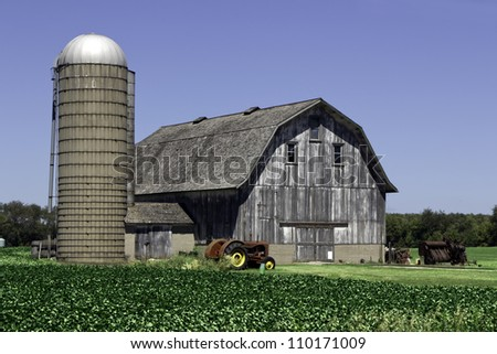 American old grey farm with tractor