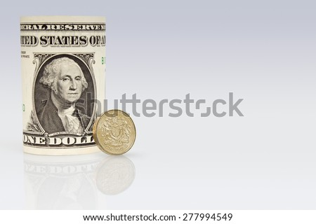 American One Dollar Bank note with a British One pound coin - stock photo